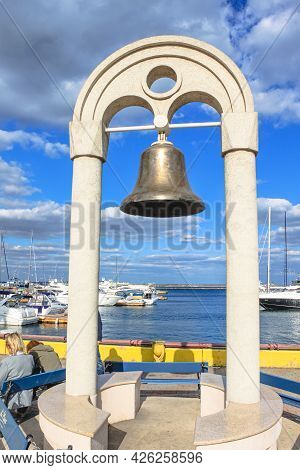 Odessa, Ukraine, October 9, 2012: The Bell On The Arch In The Seaport Of Odessa. The Ship's Bell Was