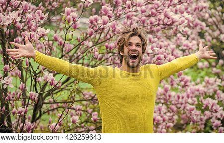 Floral Cosmetics Concept. Hipster Enjoy Blossom Aroma. Unshaven Man Magnolia Bloom. Man Flowers Back