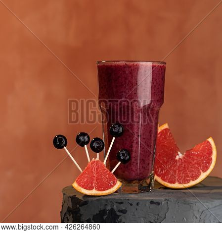 Red Berry Citrus Smoothies Cocktail. Glass Of Drink And Grapefruit Or Sicilian Orange Slices On Blur