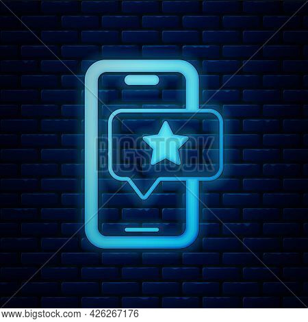 Glowing Neon Mobile Phone With Review Rating Icon Isolated On Brick Wall Background. Concept Of Test
