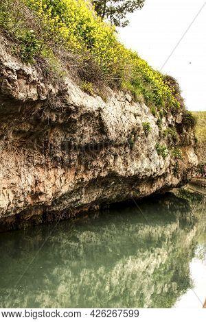 Water Channel In Alcala Del Jucar And Vegetation