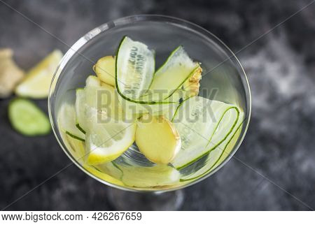 Summer Cooling Drink With Fresh Cucumber, Lemon And Ginger. Drink In A Beautiful Glass.