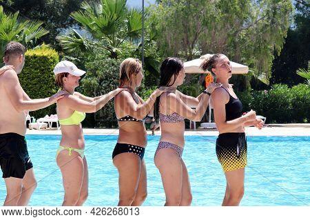 Marmaris, Turkey - July 2021: Happy People Doing Aqua Aerobics In A Swimming Pool Lined Up Like A Tr