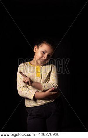 Little Girl, Portrait Of A Beautiful Little Girl In Pajamas, Black Background, Low Key Portrait, Sel
