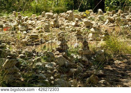 Stone Balance. The Stones Were Stacked On Top Of Each Other.a Pyramid Of Stones Stacked One On Top O