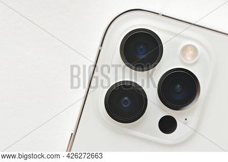 Stariy Oskol, Russia - July 5, 2021: Camera Lenses Of Modern Apple Smartphones Iphone 12 Pro