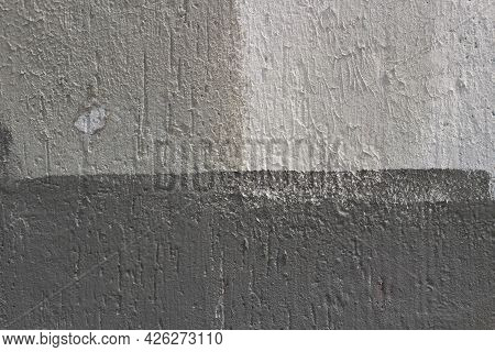 Gray Wall. Gray Painted Wall. Rough Concrete Wall In Different Shades Of Gray. Simple Background.