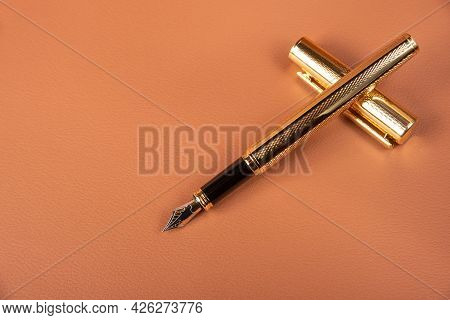 Fountain Pen, Beautiful Details Of A Fountain Pen Exposed On A Leather Surface, Selective Focus.