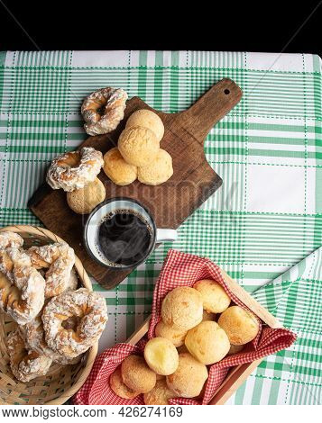Brazil Cheese Bread And Sweet Biscuit And A Cup Of Coffee On A Table With Green Checkered Tablecloth