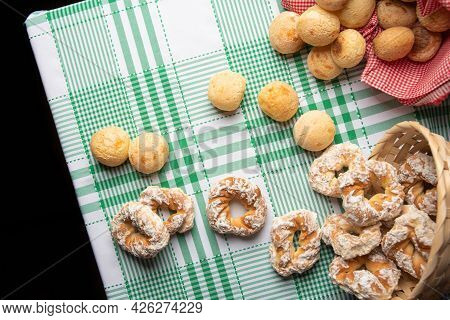 Brazil Cheese Bread And Sweet Biscuit On A Table With Green Checkered Tablecloth, Top View.