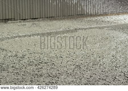 Liquid Cement At A Construction Site. Cement Spilled Onto The Road. The Building Material Is Cement