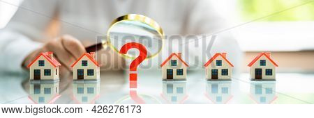 Real Estate House Appraisal By Inspector With Magnifier