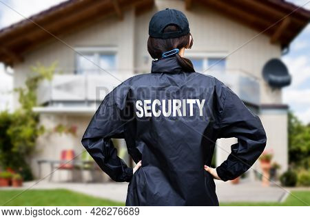 Security Guard Watching House Property. Surveillance Service