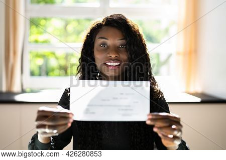 Black Business Woman Holding Pay Check Or Paycheck
