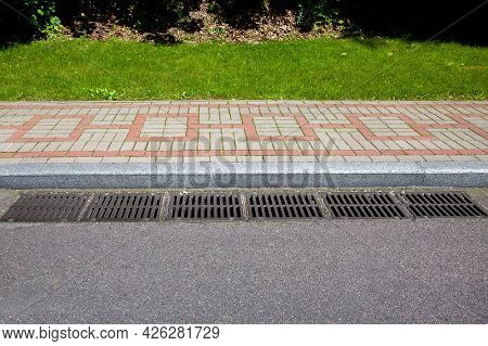 Rectangular Hatches Of The Lattice Of The Drain System For Drainage Of Rainwater From The Road Surfa