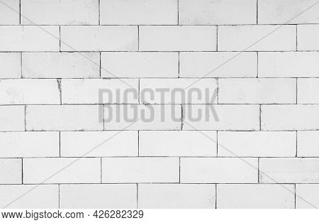 Lightweight Brick Wall For Background. Black And White Photographic Background Of A White Brick Wall