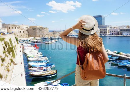 Back View Of Young Female Backpacker In Gallipoli, Salento, Italy
