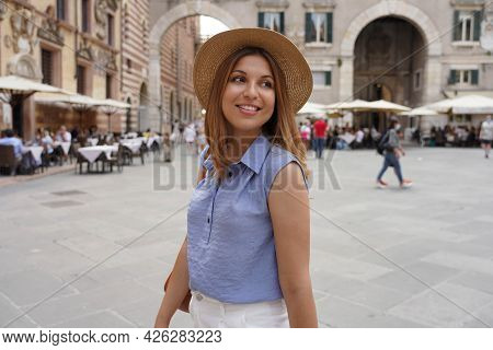 Fashionable Beautiful Woman Strolling In The Old Town Of Verona For Her Luxury Tour In Europe