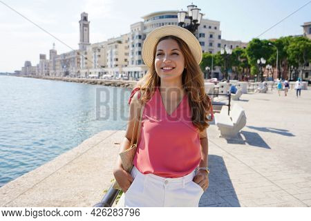 Smiling Tourist Woman Strolling On Bari Promenade, Apulia, Italy