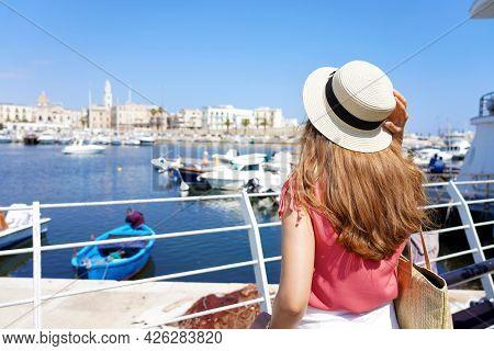Visiting Bari. Back View Of Young Traveler Woman Enjoying Cityscape Of Bari, Italy.