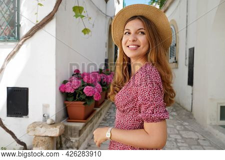 Side View Of Traveler Girl Discovering Old Town And Looking Away