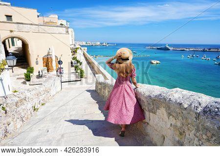 Beautiful Young Woman With Hat Walking Along The Ancient Walls Of Otranto Looking At Stunning Panora