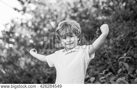 Child Outdoors In Nature. Happy Child. Funny Baby Boy Isolated On A Background Of Green Trees. Smili