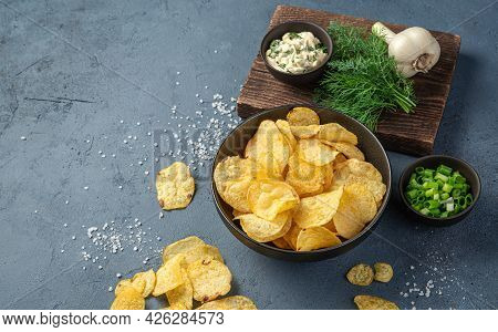 Chips With Greens And Sour Cream On A Dark Background. Appetizer. Side View, Space For Copying.