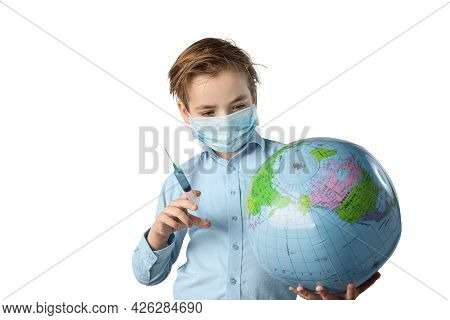 Boy In A Protective Mask Against Infection, Coronavirus Holds A Ball In The Face Of The Ground And A