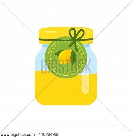 Label With Lemon On A Jar Of Confiture. Closeup Glass Jar With Lemon Jam.