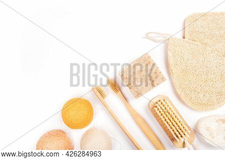Flatlay With Wooden Brush, Bamboo Toothbrushes, Bar Of Soap, Konjac And Loofahs Sponge And Cotton Ea