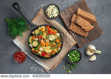 Healthy Lunch With Vegetable Stew, Fresh Herbs And Rye Bread On A Gray-brown Background. Top View, H