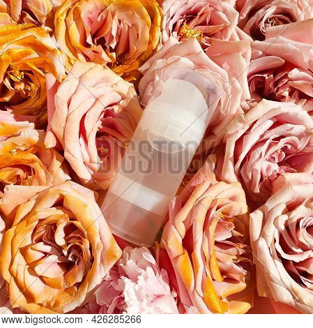 Unbranded Transparent Bottle Of Intimate Lubricant Gel And Pink Golden Roses. Intimate Massage And C