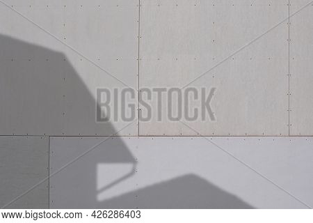 Sunlight And Shadow Of House Structure On Gray Gypsum Wall Surface