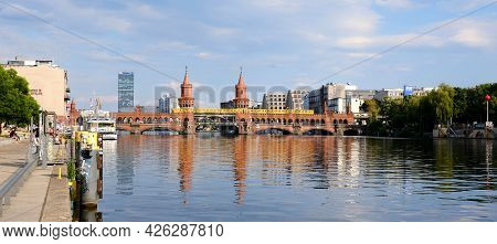 Berlin, Germany, June 28, 2021, View Over The River Spree To The Oberbaum Bridge Connecting Kreuzber
