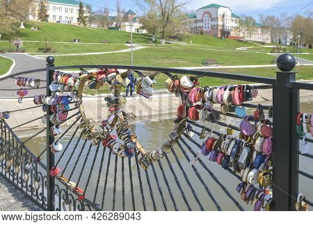 Hanging Colorful Castles In The Form Of Hearts Hang On The Bridge. A Symbol Of Love And Loyalty, A W