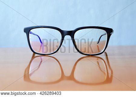 Black Plastic High Myopia Eyeglasses On The Table