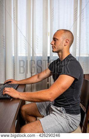 Cheerful Young Male Student Enjoying Training Webinar On Laptop Computer Preparing Coursework Plan,h
