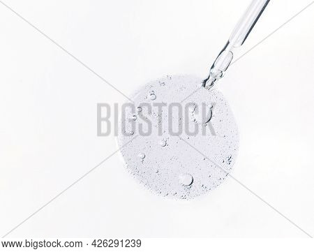 Cosmetic Serum Bubbles And Dropper With Hyaluronic Acid On White Background. Abstract Drop Of Skin C