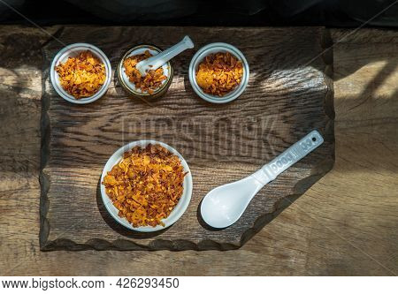 Dried Chilli Paste With Crispy Fish Thai Style Or Crispy Fish Chilli Paste In Ceramic White Cup On W