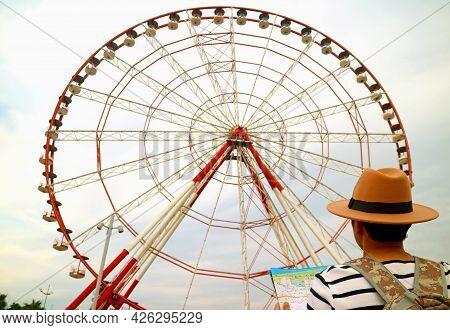 Closeup Of Traveler Looking Up To The 80 Meter High Ferris Wheel On Batumi Boulevard, A Famous Landm