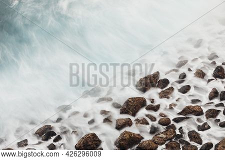 High Angle View To Stone Beach. Sea Waves On The Motion. Tenerife, Canary Islands, Spain.