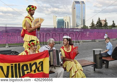 Donetsk, Ukraine - June 27, 2012: Fans Of The Spanish National Team Sing Along With The Accordionist