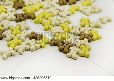 Dog Treats. Bone Shaped Cookies For Dogs. Multi Colored Bones Of Cookies Isolated On A White Backgro