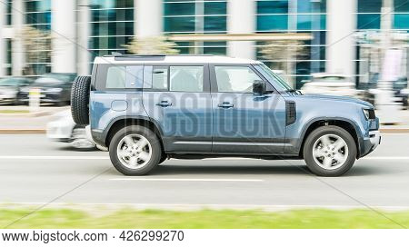 Moscow, Russia - May 2021: Land Rover Defender L663 Moving Fast On The Street Of Moscow. Blue Four-w
