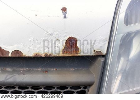 Severe Corrosion On The Old White Car. Rust On The Hood Of The Car