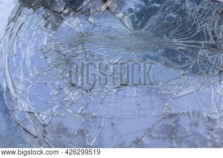 The Broken Windshield Of The Car That Was In An Accident
