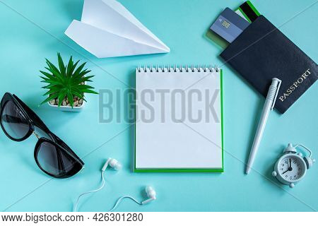 Flatlay Travel Accessories On A Blue Background. Summer Vacation Concept. Passport, Credit Cards, Su
