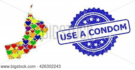 Blue Rosette Distress Stamp With Use A Condom Phrase. Vector Mosaic Lgbt Map Of Oman Of Love Hearts.