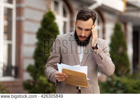 The Man Is Shocked By The Court Letter. Eviction From Home, Bankruptcy And Financial Problems.